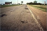 Badly deteriorated roadway
