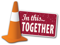 In this together sign and orange cone