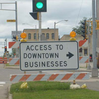 Access to downtown business baracade sign