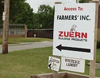 "A sign that reads, ""Access TO: Farmers' Inc., Zuern Building Products"""