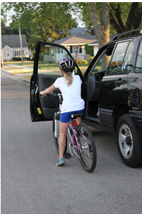 Example of car door interfering with bicycle rider.