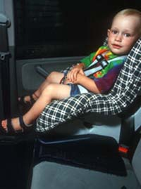 Child in safety seat