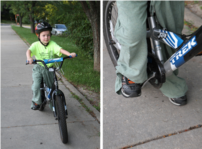 Boy bicycle rider with wrong type of pants that could get caught.