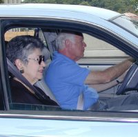 Older drivers driving in automobile