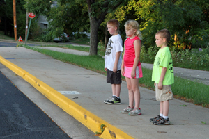 Kids standing at the curb