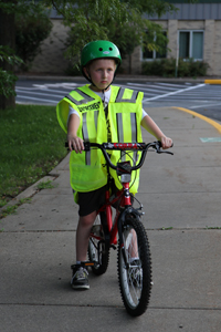 Child on bike with reflective vest