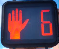 red hand and timer crosswalk light