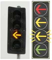 traffic signal head with a yellow flashing arrow