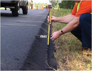 Man measuring road thickness