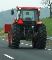Farm tractor on highway