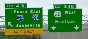 Examples of left-hand and center lane exit signs.