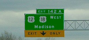 Example of a right-hand exit sign.