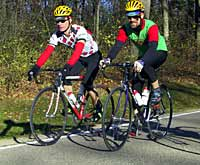 Two men riding bicycles to work