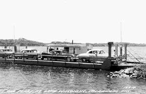 Black and white photo of the Merrimac Ferry, Colsac I, with cars about to unload.